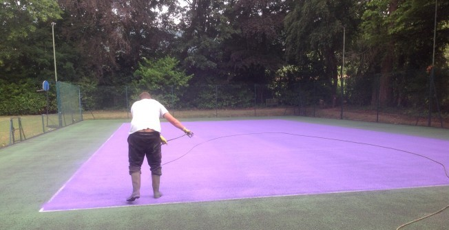 Painting MUGA Surfacing in Balsham